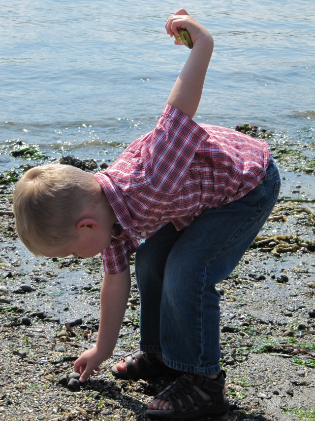 Throwing rocks at the beach.
