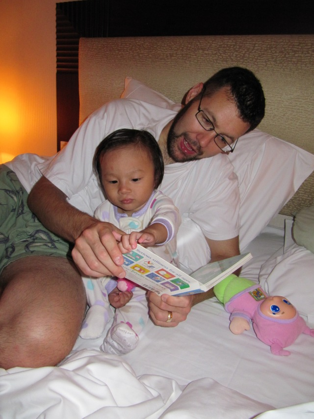Li Li was actually happy to be back at the hotel tonight.  Reading with Baba before bed.