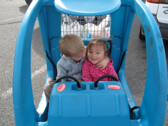Grocery shopping today, Koen enjoyed riding in the car cart with his sister so much that he leaned over and gave her a smooch!