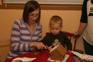 Helping Koen decorate his gingerbread house.