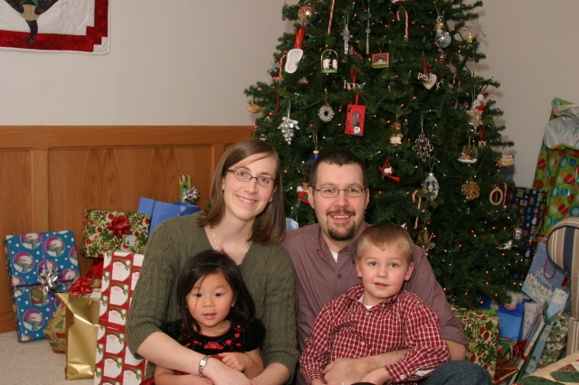 Traditional Family Photo on Christmas Eve - in front of Grammi's tree.